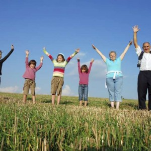 Donate-time-Volunteer-family-with-arms-in-the-air-300x300